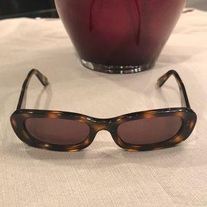 Vintage Chanel sunglasses with original case.